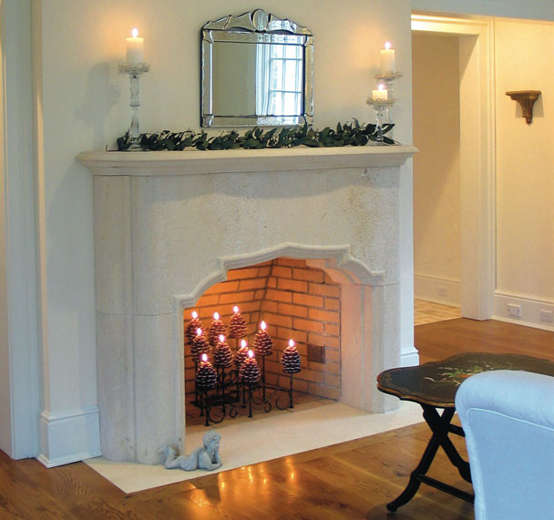 Custom limestone fireplace surround in Cordoba Cream.