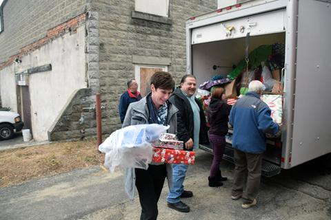 Lynn Robotham delivers toys to the Torrington Youth Service Bureau