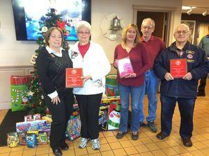 Representatives of the three largest contributors to the Torrington Firefighters Association's annual toy drive were awarded plaques Wednesday for their efforts. From left, Sharon Okraska and Shirley Durante of O&G Industries, Bonnie and Mike Hand of Staples Tavern, and Phil Dzurnak of the Torrington Lions Club. Taylor Rapalyea/Republican-American
