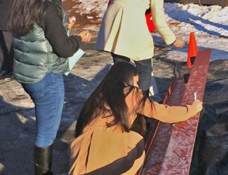 Students from Rocky Hill High School sign the ceremonial beam